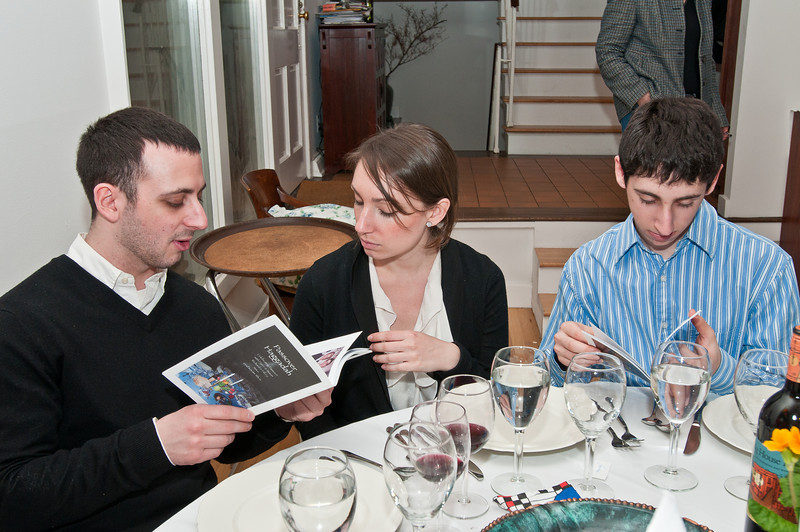 Steve, Lauren, and Ben look at the home-made seder Hagaddah's