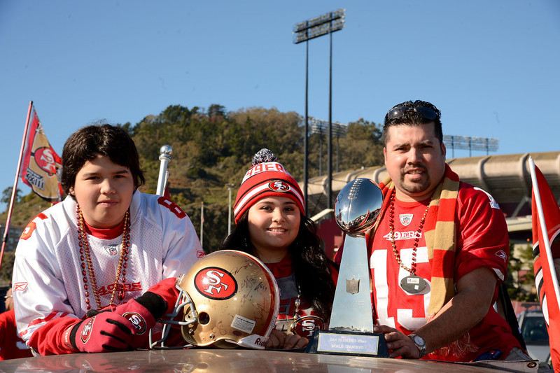 . (L-R) San Francisco 49ers fans Ruben Reyes, Cassandra Marie Reyes and Jose Reyes of San Francisco, California pose prior to the NFC Divisional Playoff Game between the Green Bay Packers and the San Francisco 49ers at Candlestick Park on January 12, 2013 in San Francisco, California.  (Photo by Thearon W. Henderson/Getty Images)