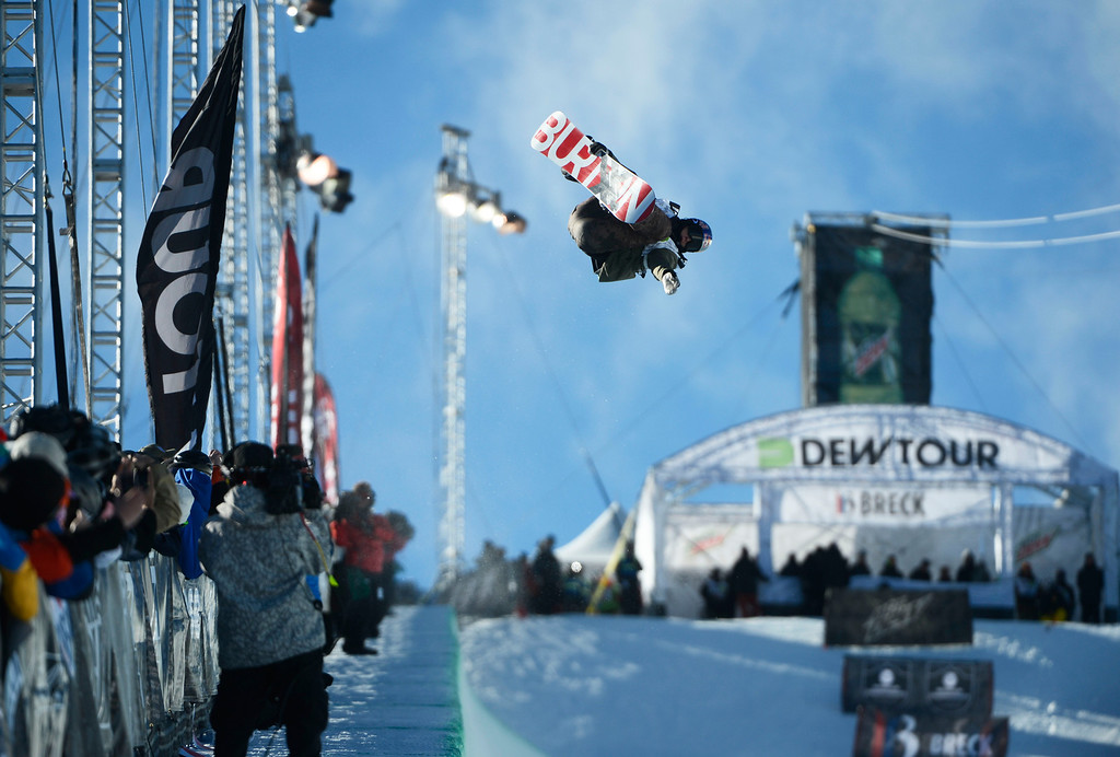 . Pro Snowboarder, James Scotty, heads down the superpipe at Breckenridge during the Dew Tour Ion Mountain superpipe championship finals at Breckenridge Saturday afternoon, December 14, 2013. (Photo By Andy Cross/The Denver Post)