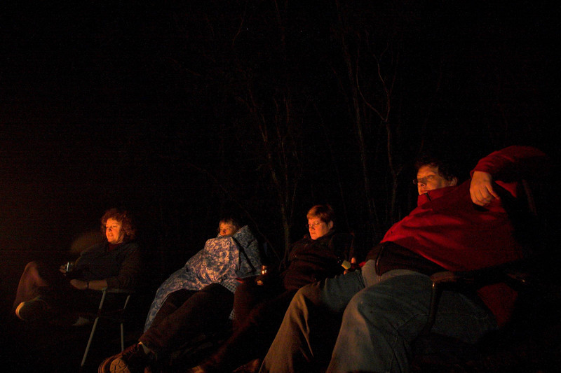 Sitting around a camp fire having a bit of a drink, some chocolate, some toasted marshmellows. We could do this for hours. Jacinta, Janet, Jenny, Dennis.