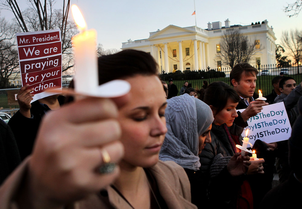 Description of . People gather outside the White House to participate in a candle light vigil to remember the victims at the Sandy Hook Elementary School shooting in Newtown, Connecticut on December 14, 2012 in Washington, DC.  According to reports, there are about 27 dead, 18 children, after a gunman opened fire in at the Sandy Hook Elementary School. The shooter was also killed.  (Photo by Alex Wong/Getty Images)