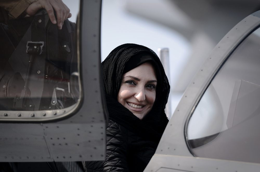 . A Bahraini woman looks at an aircraft during the opening of the Bahrain International Airshow 2014, in Sakhir, south of the capital Manama, on January 16, 2014. (MOHAMMED AL-SHAIKH/AFP/Getty Images)