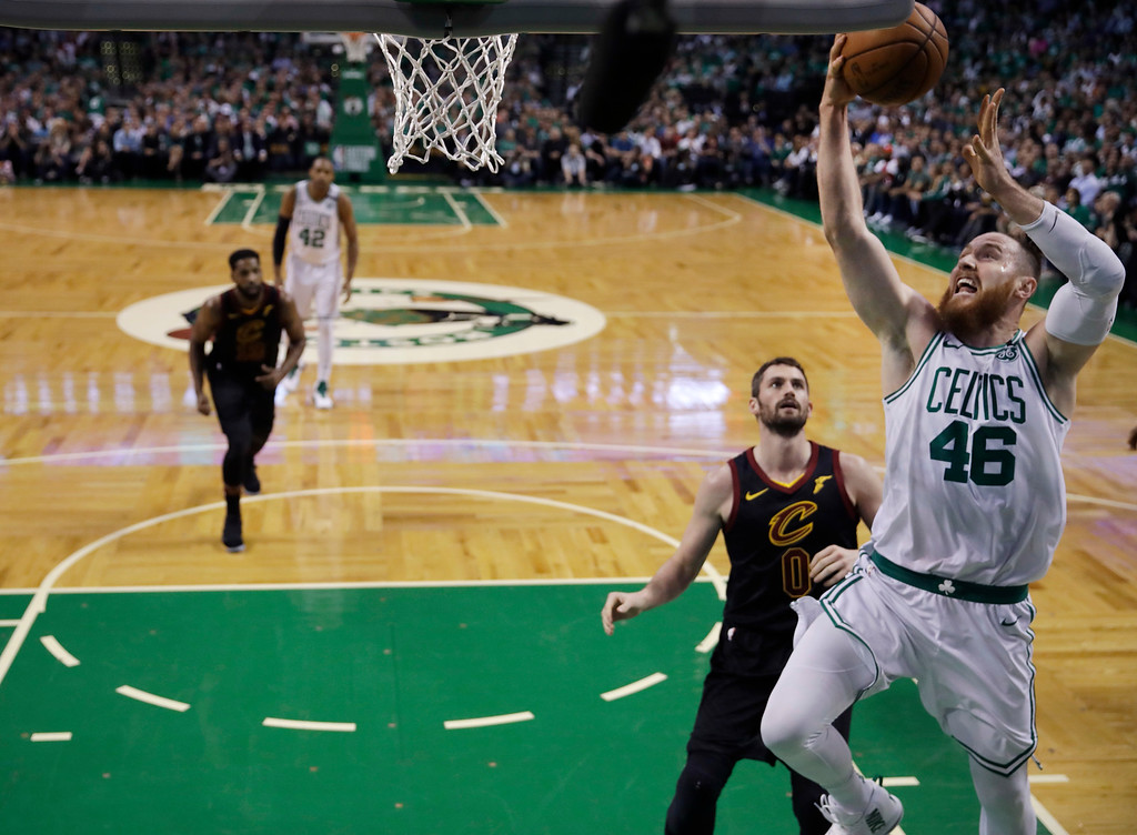 . Boston Celtics center Aron Baynes (46) goes to the hoop past Cleveland Cavaliers center Kevin Love (0) during Game 5 of the NBA basketball Eastern Conference Finals, Wednesday, May 23, 2018, in Boston. (AP Photo/Charles Krupa)