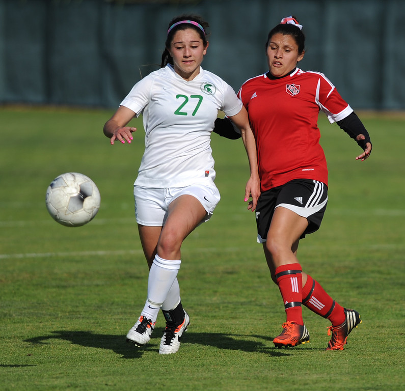 . 02-21-2012--(LANG Staff Photo by Sean Hiller)- South Torrance girls soccer beat Artesia 5-0 in Thursday\'s CIF Southern Section Division IV quarterfinal at South High. Jessica Nakae (27), left, battles Artesia\'s Icseel Ortiz (19).