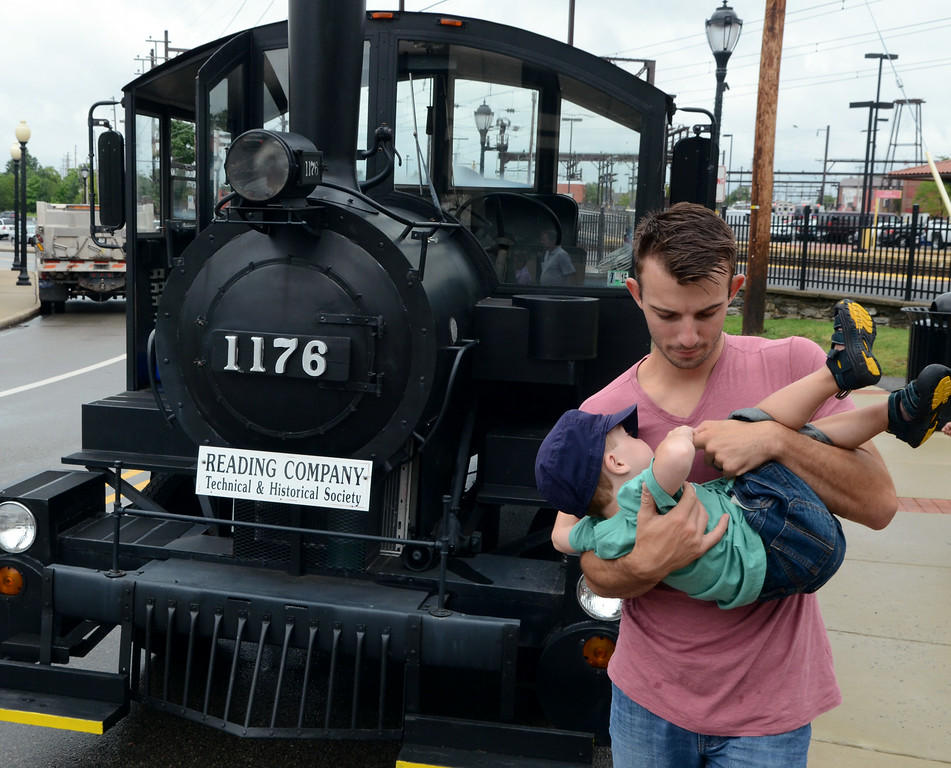 . Families check out a miniature train of the Reading Company Technical & Historical Society during the Lansdale Founders Day  celebration and on Saturday August 23,2014. Photo by Mark C Psoras/The Reporter
