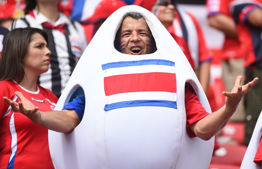 . Costa Rica fans cheer prior to a Group D football match between Italy and Costa Rica at the Pernambuco Arena in Recife during the 2014 FIFA World Cup on June 20, 2014.     AFP PHOTO / EMMANUEL  DUNAND/AFP/Getty Images