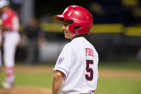 08/08/19 Wesley Bunnell | Staff New York defeated Washington, DC 15-4 on Thursday August 8, 2019 in a Mid Atlantic Region tournament game. Daniel Piho (5) smiles at his first base coach after lining a single.