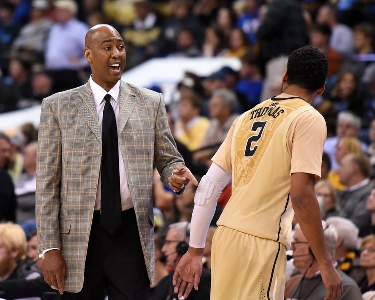 Coach Manning & Devin Thomas.jpg