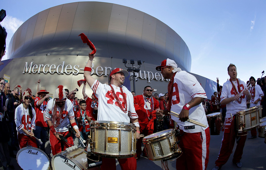 . Members of the Niner Noise Drumline perform outside of the Superdome before the NFL Super Bowl XLVII football game between the San Francisco 49ers and the Baltimore Ravens on Sunday, Feb. 3, 2013, in New Orleans. (AP Photo/Elise Amendola)