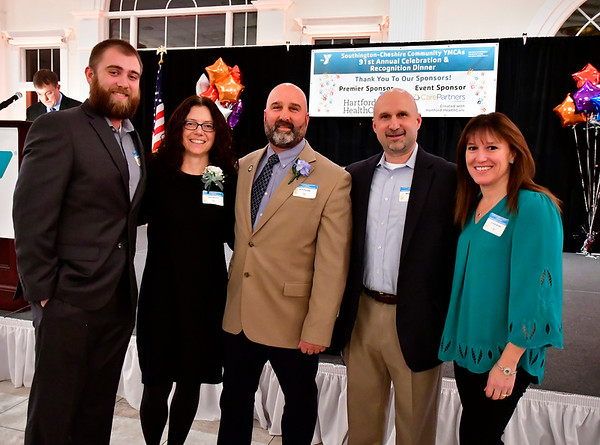 2/5/2020 Mike Orazzi | StaffrPerson of the Year Brian Goralski (center) with his son Andrew, wife Cathy and brother Mike and his wife Kristin during the Southington-Cheshire YMCA's 91st Annual Celebration & Recognition Dinner held at the Aqua Turf Club on Wednesday night.