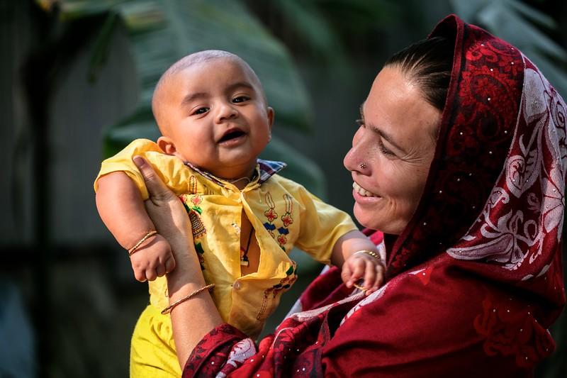 0215-0227A village mother posing for photos with her child.Dakua Union Golachepa, Potuakhali. Bangladesh.Photo Credit: b.a.sujaN / Map / WRA
