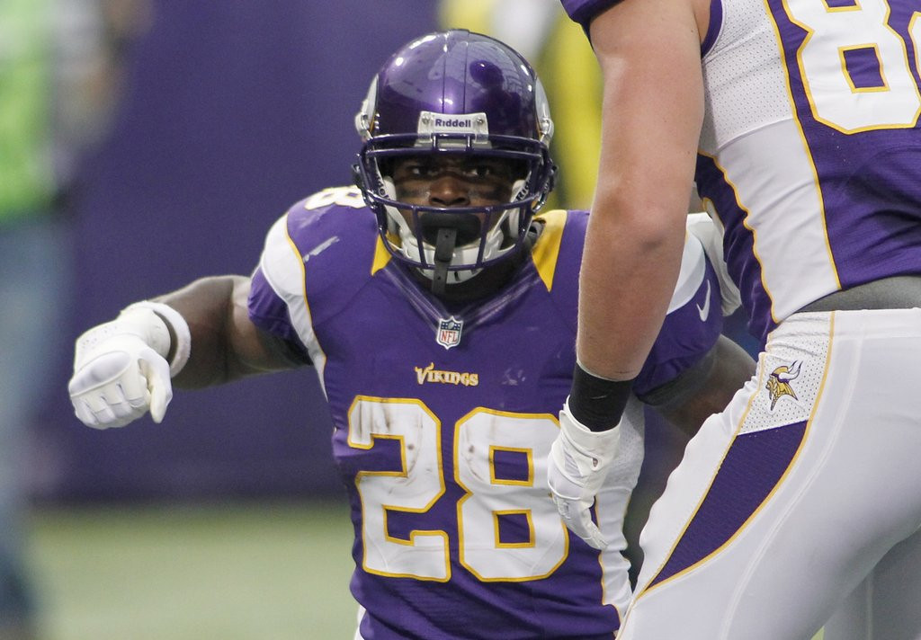 . <p><b> Vikings at Lions (-5):</b>  <p>Numbers geeks will have a field day: Adrian Peterson begins his quest for 2,500 yards, and Matthew Stafford throws the first of his 2,500 passes. <p>Pick: <b>Lions by 3</b> <p>   (AP Photo/Andy King)