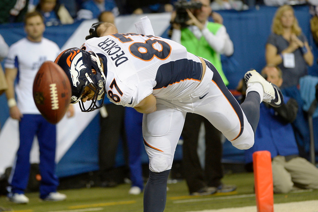 . INDIANAPOLIS, IN. - October 20: wide receiver Eric Decker (87) of the Denver Broncos spikes the ball in the end zone after his first half touchdown vs the Indianapolis Colts at Lucas Oil Stadium. October 20, 2013 Indianapolis, Indiana. (Photo By Joe Amon/The Denver Post)