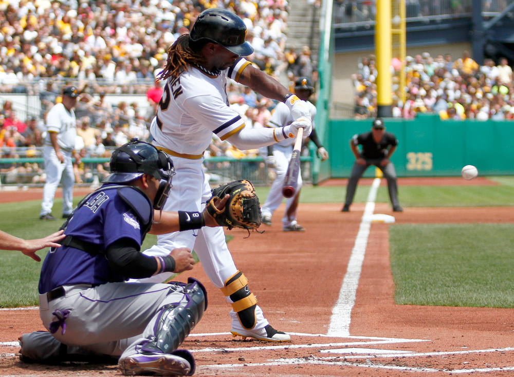 . Andrew McCutchen #22 of the Pittsburgh Pirates hits an RBI single in the first inning against the Colorado Rockies during the game on August 4, 2013 at PNC Park in Pittsburgh, Pennsylvania.  (Photo by Justin K. Aller/Getty Images)
