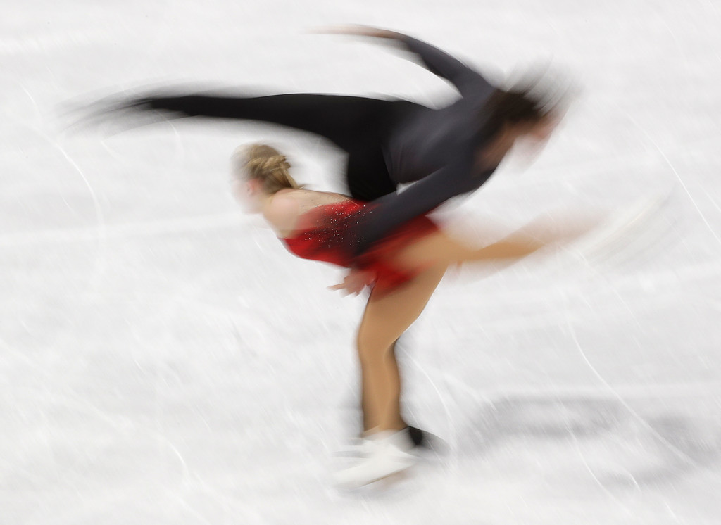 . Julianne Seguin and Charlie Bilodeau, of Canada, perform in the pairs free skate figure skating final in the Gangneung Ice Arena at the 2018 Winter Olympics in Gangneung, South Korea, Thursday, Feb. 15, 2018. (AP Photo/David J. Phillip)
