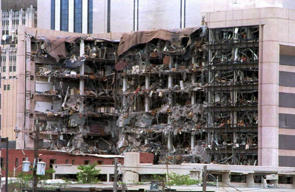 . The north side of the Alfred Murrah Federal Building in Oklahoma City, OK shows the damage caused by a bomb that was detonated 19 April 1995.  Tim McVeigh and Terry Nichols stand accused in the bombing.  (BOB DAEMMRICH/AFP/Getty Images)