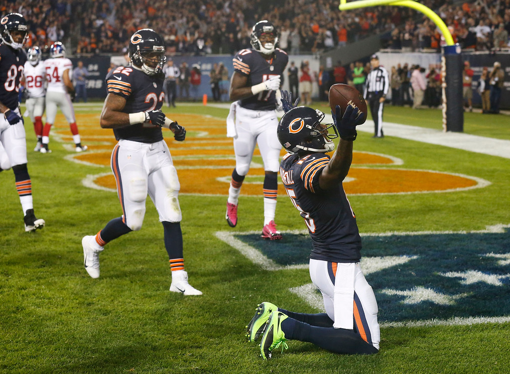 . Chicago Bears wide receiver Brandon Marshall (15) celebrates his touchdown reception in the end zone in the first half of an NFL football game against the New York Giants, Thursday, Oct. 10, 2013, in Chicago. (AP Photo/Charles Rex Arbogast)