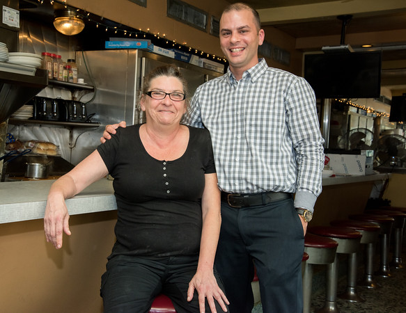 05/17/18 Wesley Bunnell | Staff New owner of Miss Washington Diner Judy Robinson poses with previous owner Dan Czako on Thursday afternoon inside of the restaurant. Robinson previously waitressed for 37 years before purchasing it from Czako who owned the diner since 2011.