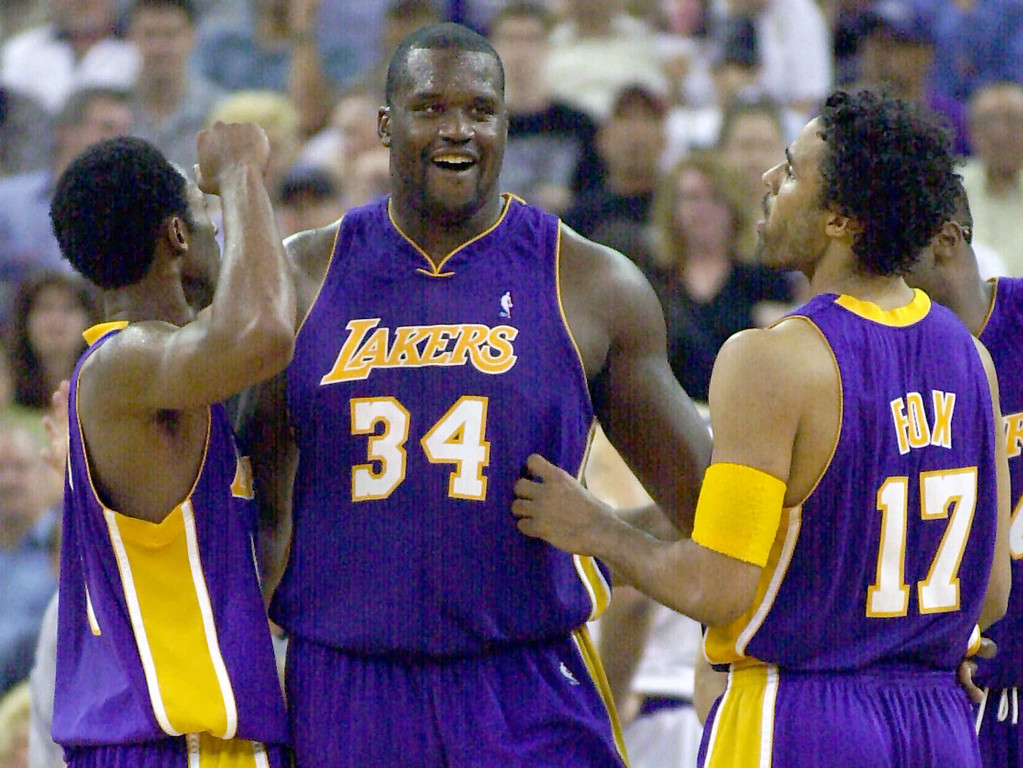 . Los Angeles Lakers\' Shaquille O\'Neal, center, Kobe Bryant, left, and Rick Fox celebrate a play late in the second half of game three of the Western Conference semifinals against the Sacramento Kings Friday, May 11, 2001, in Sacramento. The Lakers won the game, 103-81 to take a 3-0 lead in the best-of-seven series.  (AP Photo/Mark Terrill)
