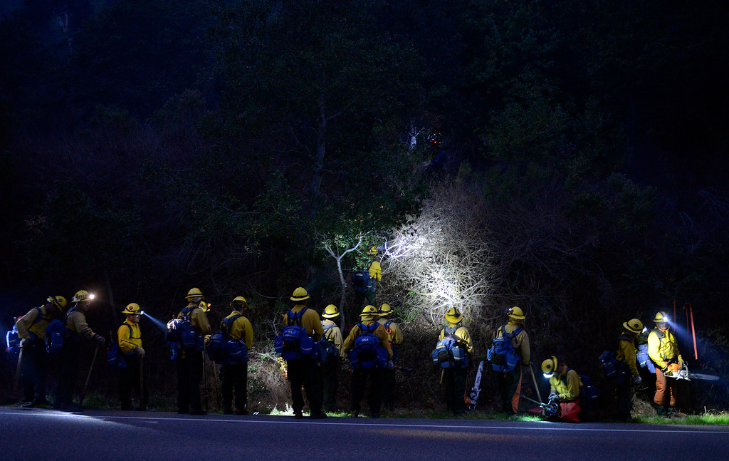 . A fire crew from Sequoia heads up off Highway 1 as dusk falls to battle the fire as it creeps toward the Big Sur Station from the Pfeiffer Ridge area in Big Sur, Calif. on Tuesday December 17, 2013. (Photo David Royal/ Monterey County Herald)