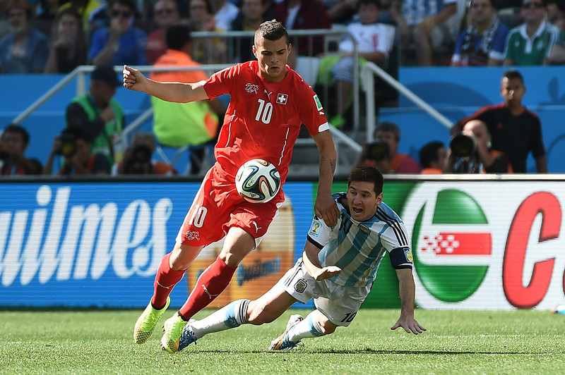 . Switzerland\'s midfielder Granit Xhaka (L) and Argentina\'s forward and captain Lionel Messi vie for the ball during the Round of 16 football match between Argentina and Switzerland at the Corinthians Arena in Sao Paulo during the 2014 FIFA World Cup on July 1, 2014.  (ANNE-CHRISTINE POUJOULAT/AFP/Getty Images)
