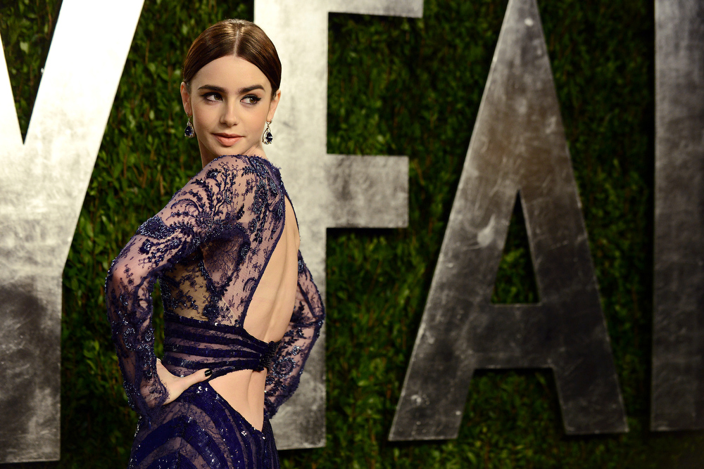 . Actress Lily Collins arrives at the 2013 Vanity Fair Oscars Viewing and After Party on Sunday, Feb. 24, 2013, at the Sunset Plaza Hotel in West Hollywood, Calif. (Photo by Jordan Strauss/Invision/AP)