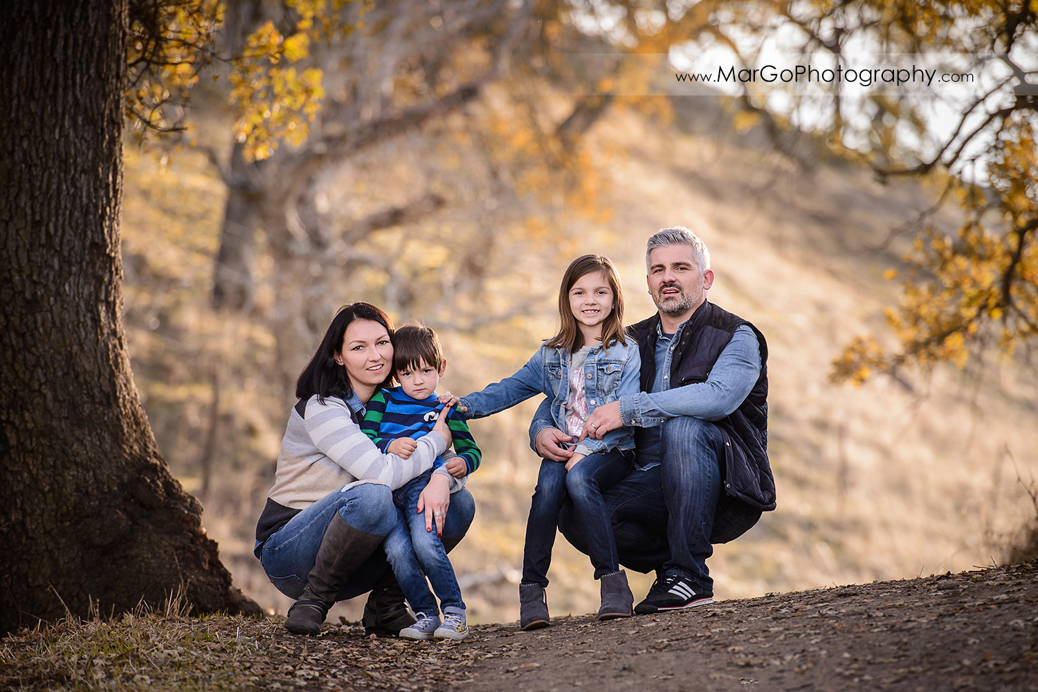full body horizontal portrait of family of four during family session at Diablo Foothills Regional Park in Walnut Creek