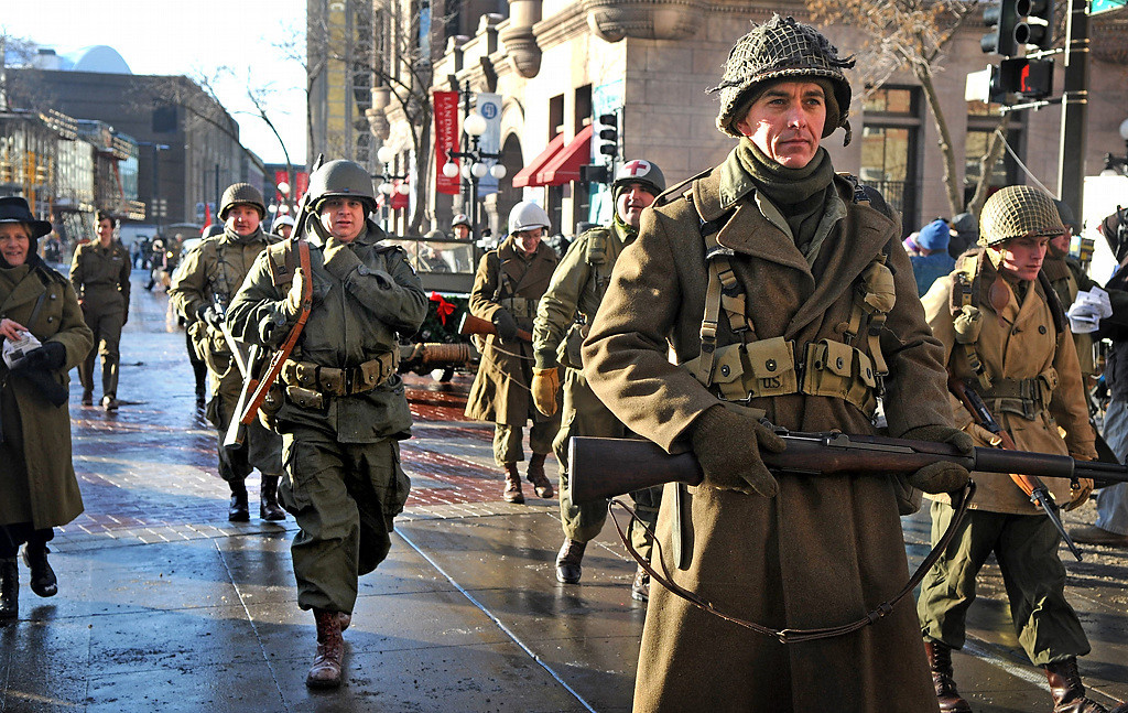 . Members of the Commemorative Air Force-Minnesota Wing march by the Landmark Center at the Winter Carnival Grande Day Parade in St. Paul, Saturday January 25, 2014. (Pioneer Press: Jean Pieri)