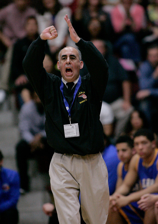 . Serra coach Chuck Rapp yells instructions to his players in the first quarter during the CCS Open Division boys basketball finals at Santa Clara University in Santa Clara, Calif. on Saturday, March 2, 2013. The Archbishop Mitty Monarchs played the Serra Padres. (Jim Gensheimer/Staff)