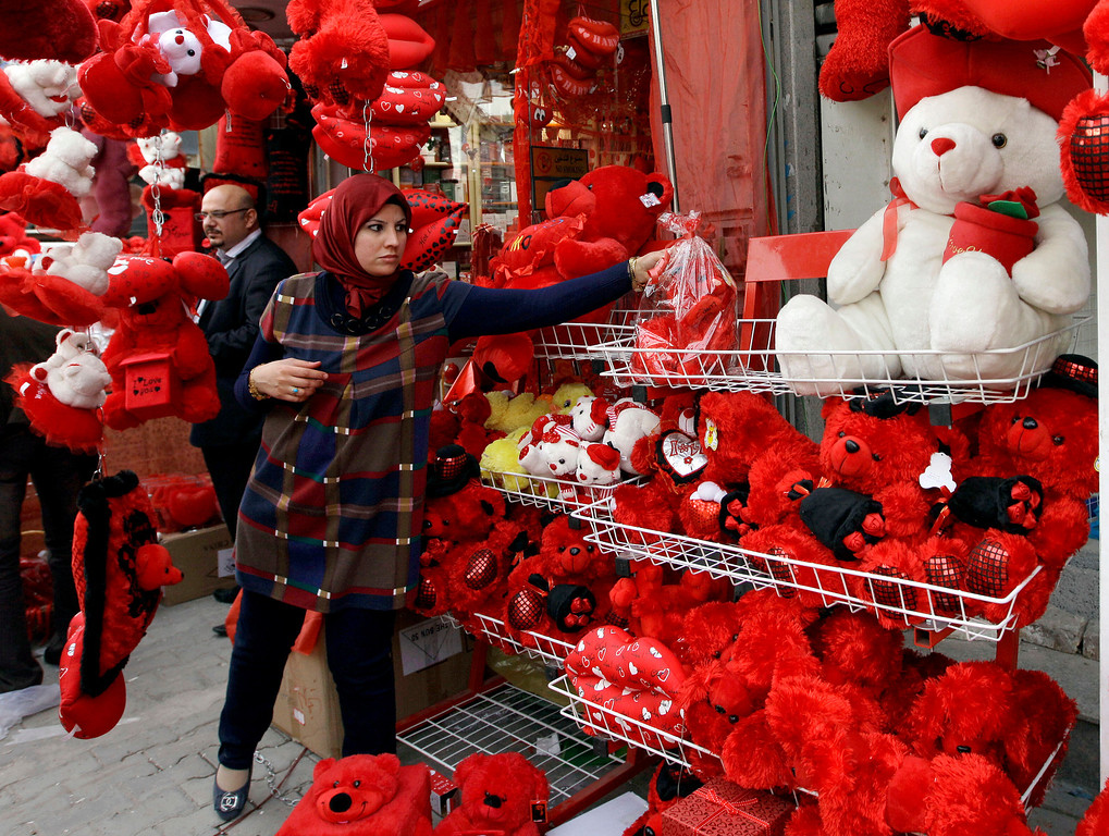 . A woman shops for a Valentine\'s Day present in central Baghdad, Iraq, Thursday, Feb. 14, 2013. (AP Photo/ Khalid Mohammed)