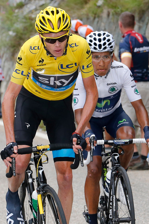. Christopher Froome of Britain, wearing the overall leader\'s yellow jersey, and Nairo Alexander Quintana of Colombia, wearing the best young rider\'s white jersey, climb towards Alpe-d\'Huez pass during the eighteenth stage of the Tour de France cycling race over 172.5 kilometers (107.8 miles) with start in Gap and finish in Alpe-d\'Huez, France, Thursday July 18, 2013. (AP Photo/Joel Saget, Pool)
