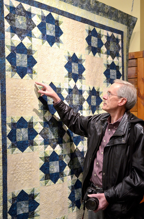 ". Jeff Forman/JForman@News-Herald.com Ron Sieloff, of Chardon, talks about his quilt ""Weathervane Wonder\"" during the opening reception for the Quilts 2014 show Thursday at Lake Metoparks Farmpark."