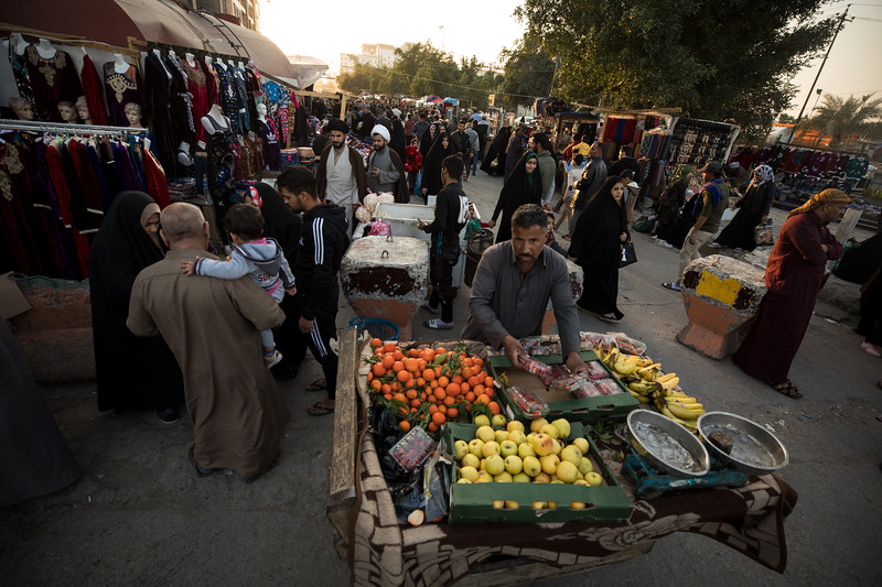 A fruit vendor in an open street market in the city of Najaf.