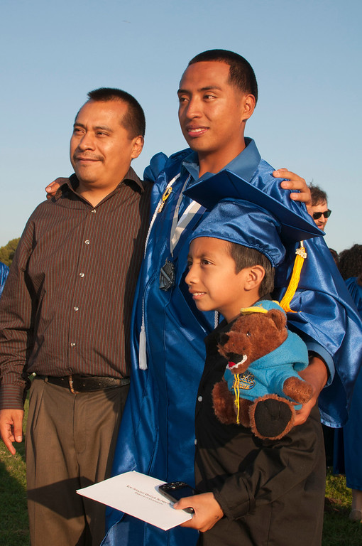 . Frank Lopez takes photos with his father and little brother.  The Reseda High School graduation class held their commencement in the school football field on Friday,  June 07, 2013 in Reseda, CA.   Photo by Carlos Carpio