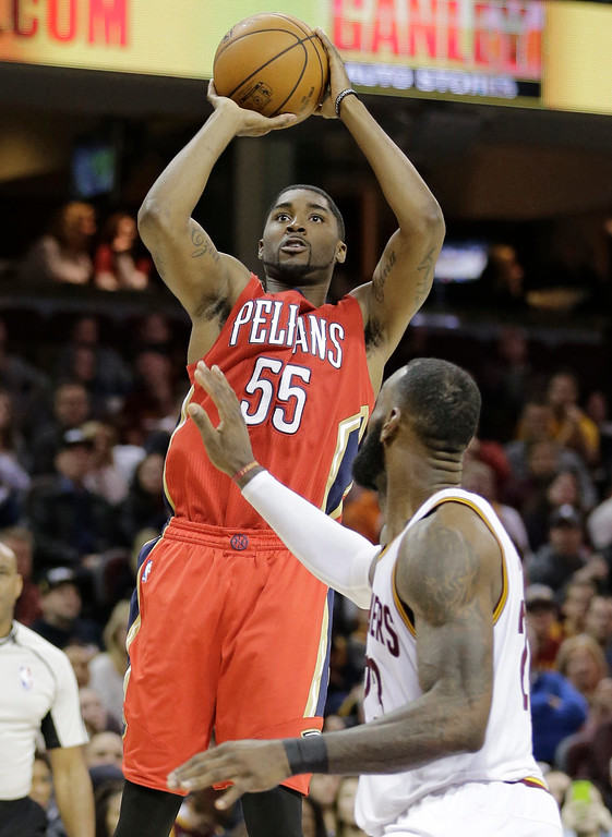 . New Orleans Pelicans\' E\'Twaun Moore (55) shoots over Cleveland Cavaliers\' LeBron James (23) in the second half of an NBA basketball game, Monday, Jan. 2, 2017, in Cleveland. The Cavaliers won 90-82. (AP Photo/Tony Dejak)