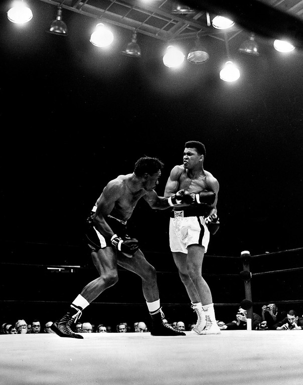 . Cassius Clay exchanges punches with Charley Powell in the first round of the scheduled 10-round heavyweight title fight in Pittsburgh, Pa., Jan. 24, 1963.  Clay knocked out Powell in the third round.  (AP Photo/Dozier Mobley)