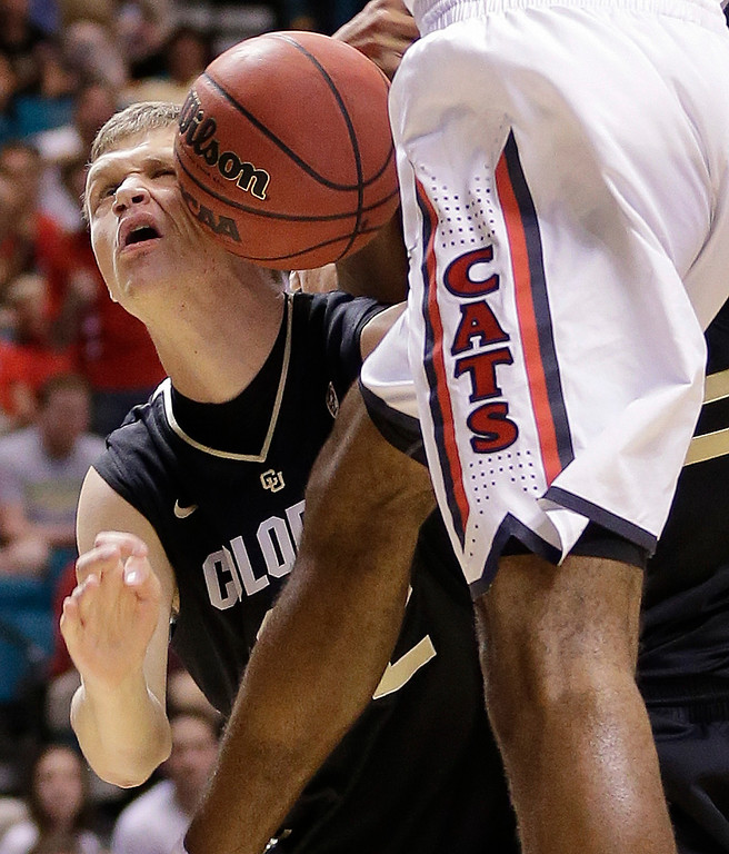 . Colorado\'s Ben Mills is hit in the face with the ball while scrambling for a rebound against Arizona in the first half during a Pac-12 tournament NCAA college basketball game, Thursday, March 14, 2013, in Las Vegas. (AP Photo/Julie Jacobson)
