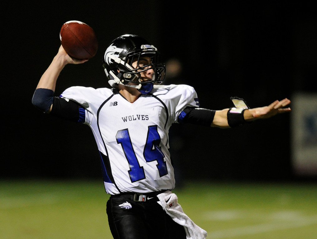 . HIGHLANDS RANCH, CO. - SEPTEMBER 13: Wolves\' quarterback Tyler Smith dropped back to pass in the fourth quarter. The ThunderRidge High School football team defeated Grandview 21-7 at Shea Stadium Friday night, September 13, 2013.  Photo By Karl Gehring/The Denver Post