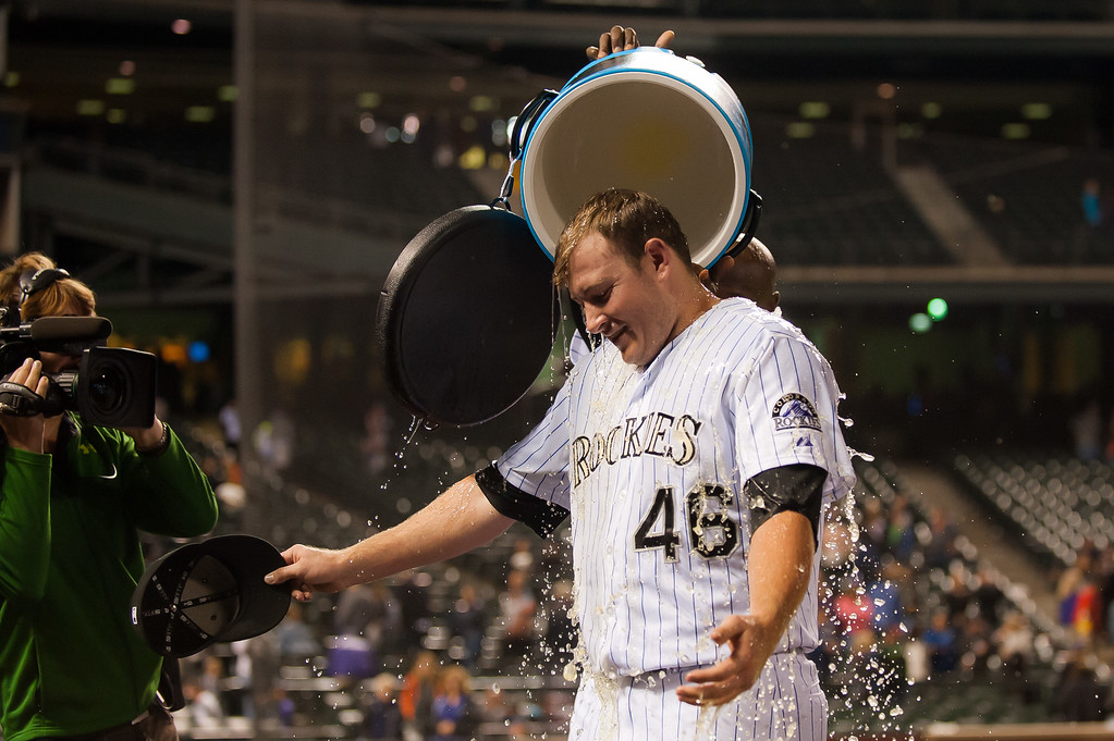 . DENVER, CO - SEPTEMBER 05:  Tyler Matzek #46 of the Colorado Rockies has Gatorade poured on him by teammate LaTroy Hawkins #32 after pitching a complete game shutout against the San Diego Padres at Coors Field on September 5, 2014 in Denver, Colorado.  (Photo by Dustin Bradford/Getty Images)