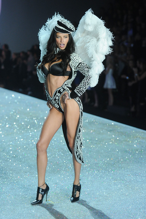 . Model Adriana Lima walks the runway at the 2013 Victoria\'s Secret Fashion Show at Lexington Avenue Armory on November 13, 2013 in New York City.  (Photo by Jamie McCarthy/Getty Images)