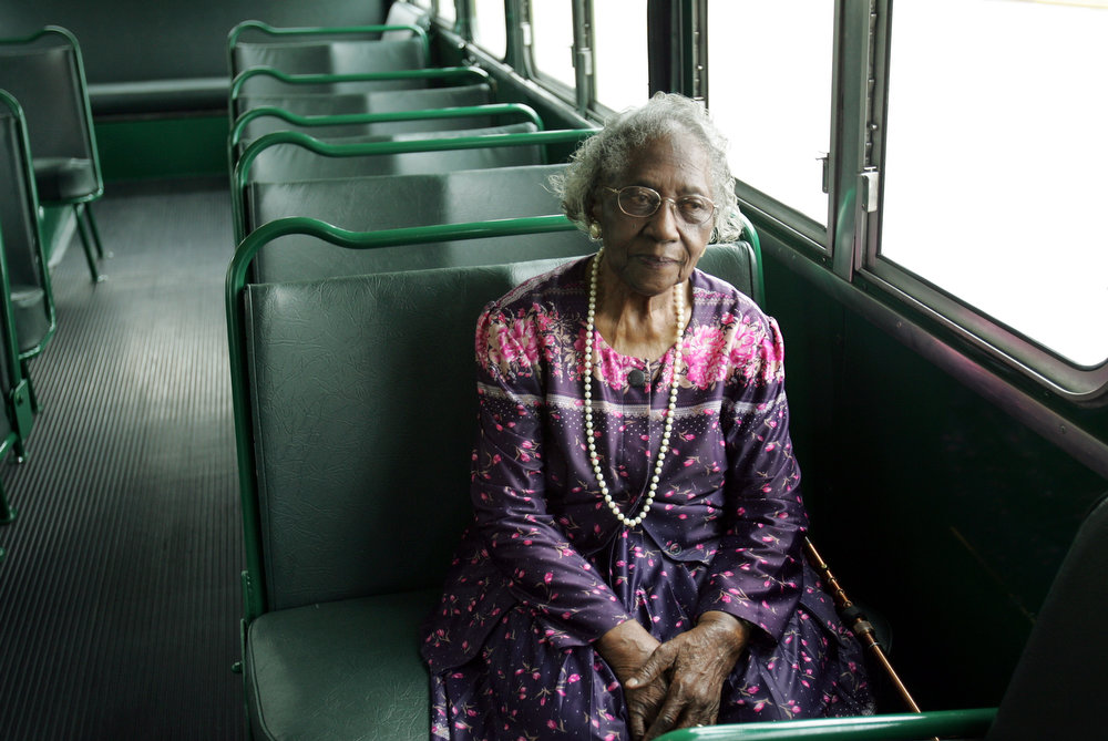 Description of . Johnnie Carr, president of the Montgomery Improvement Association, waits to be interviewed while sitting inside a 1950's era city bus, similar to the one ridden by Rosa Parks during a news conference Thursday Aug. 25, 2005 at the Dexter-King Memorial Baptist Church in Montgomery, Ala. The association announced plans for the upcoming 50th Anniversary of the historic Montgomery Bus Boycott. (AP Photo/Rob Carr)