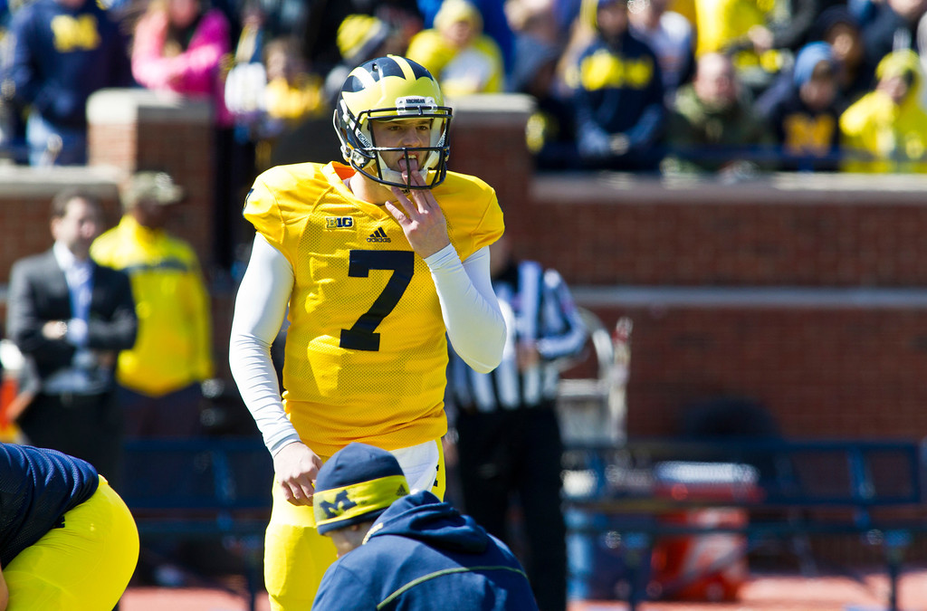 . Michigan quarterback Shane Morris (7) licks his finger during the football team\'s annual spring game, Saturday, April 5, 2014, in Ann Arbor, Mich. (AP Photo/Tony Ding)