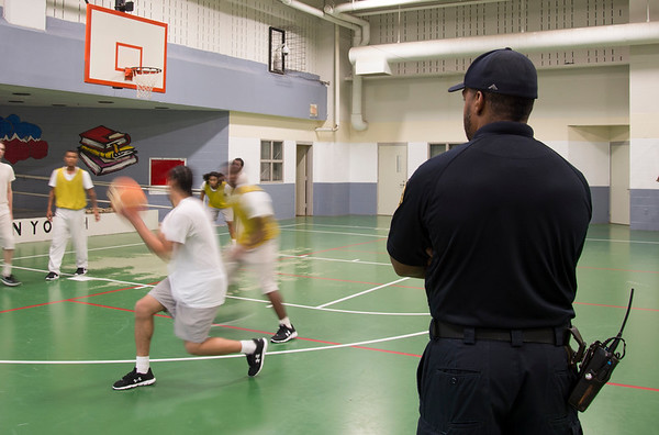 08/14/19 Wesley Bunnell | StaffrrThe Manson Youth Institution is implementing a basketball league, based off the New Britain Legacies Youth Development & Basketball Program, for inmates aged 14 to 21 to have a chance to play organized basketball with the qualification that inmates abide by the strict rules of the facility. A correctional officer stands to the side as inmates participate in a practice game. r
