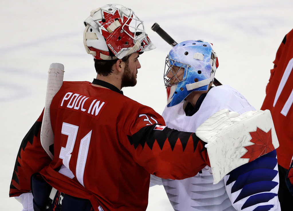 . Kevin Poulin (31), of Canada, greets Matt Dalton (1), of South Korea, after the preliminary round of the men\'s hockey game at the 2018 Winter Olympics in Gangneung, South Korea, Sunday, Feb. 18, 2018. Canada won 4-0. (AP Photo/Matt Slocum)