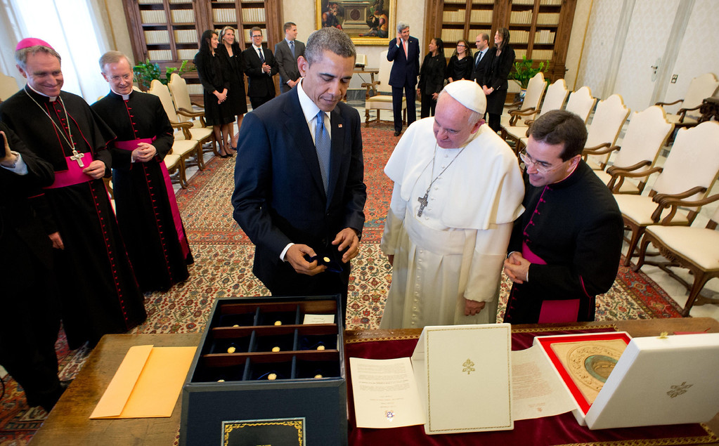 . This handout picture released on March 27, 2014 by the Vatican press office shows Pope Francis (C) and US President Barack Obama exchanging gifts during a private audience at the vatican. AFP PHOTO / OSSERVATORE ROMANO/AFP/Getty Images