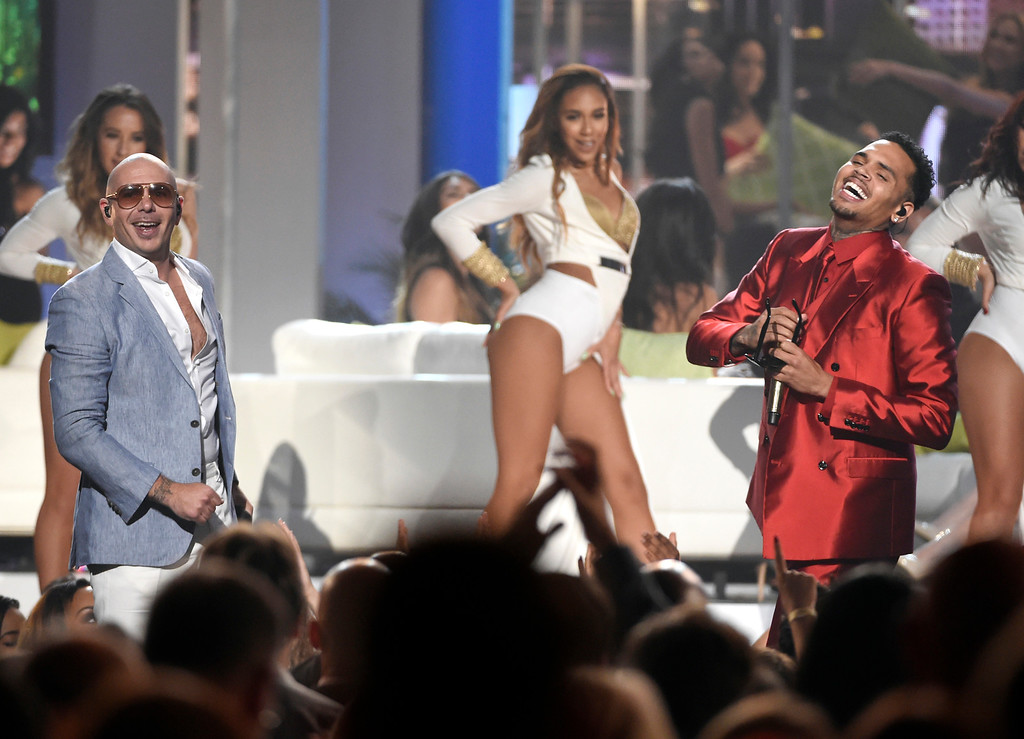 . Pitbull, left, and Chris Brown perform at the Billboard Music Awards at the MGM Grand Garden Arena on Sunday, May 17, 2015, in Las Vegas. (Photo by Chris Pizzello/Invision/AP)