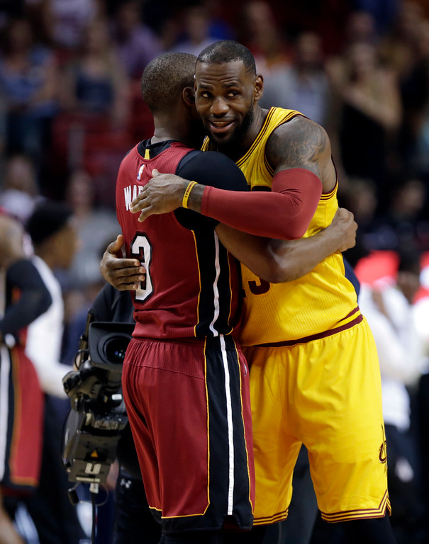 . Miami Heat guard Dwyane Wade (3) and Cleveland Cavaliers forward LeBron James hug before an NBA basketball game, Saturday, March 19, 2016, in Miami. (AP Photo/Lynne Sladky)
