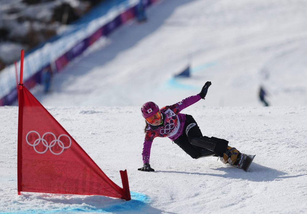 . Japan\'s Tomoka Takeuchi competes in the women\'s snowboard parallel giant slalom semifinal at the Rosa Khutor Extreme Park, at the 2014 Winter Olympics, Wednesday, Feb. 19, 2014, in Krasnaya Polyana, Russia. Takeuchi took the silver medal. (AP Photo/Sergei Grits)