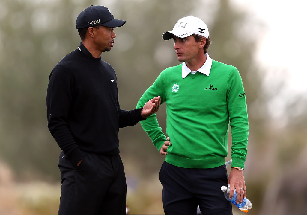 . MARANA, AZ - FEBRUARY 21:  (L-R) Tiger Woods and Charles Howell III talk on the 11th hole tee box during the first round of the World Golf Championships - Accenture Match Play at the Golf Club at Dove Mountain on February 21, 2013 in Marana, Arizona. Round one play was suspended on February 20 due to inclimate weather and is scheduled to be continued today.  (Photo by Jed Jacobsohn/Getty Images)