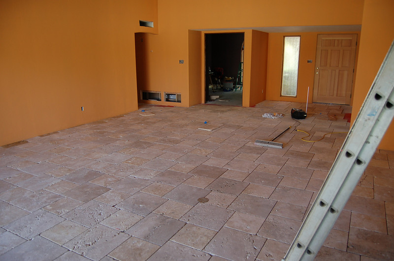 I remember not being able to walk on the tile after it was first installed, until the mastic was set.